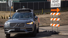 In Pittsburgh, where Uber is testing self-driving cars, each autonomous vehicle has two employees in the front seat; one is ready to grab the wheel and apply a foot to the brake pedal, the other in the passenger seat, has a computer screen showing what the car's rooftop laser-bouncing radar is seeing.