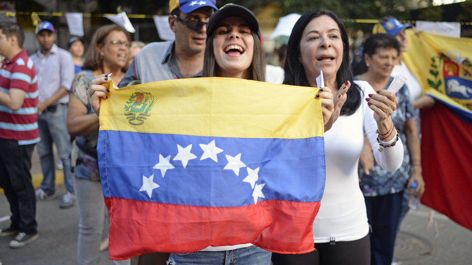 Activists celebrate Sunday in Caracas after voting in an opposition-organized referendum on President Nicolas Maduro's plan to rewrite the country's constitution.