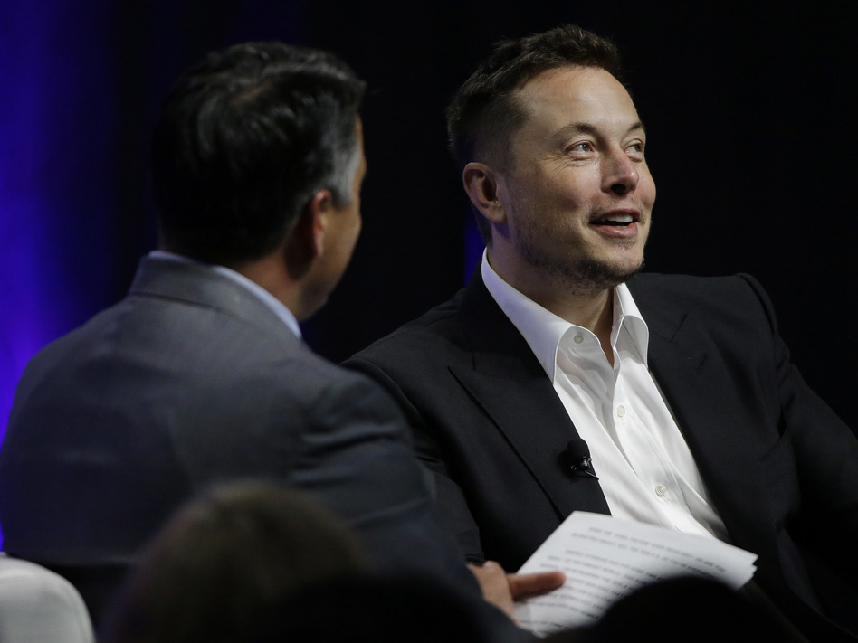 Artificial intelligence poses an existential risk to human civilization, Elon Musk (right) told the National Governors Association meeting Saturday in Providence, R.I. (Stephan Savoia/AP)