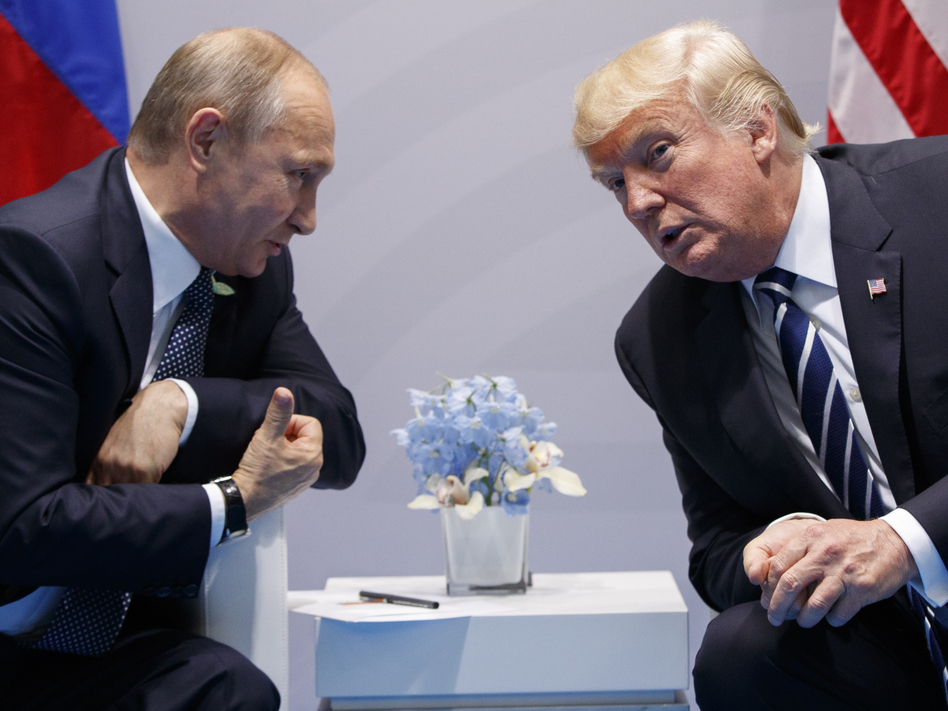 President Trump with Russian President Vladimir Putin at the G-20 Summit in Hamburg, Germany, during a formal meeting on July 7. The White House on Tuesday acknowledged that a second, previously undisclosed meeting between the leaders also took place. (Evan Vucci/AP)