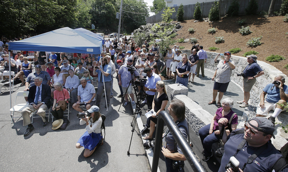 Wednesday's dedication of a memorial honoring those executed during the Salem witch trials draws a crowd to where researchers say was the site of the hangings. (Stephan Savoia/AP)