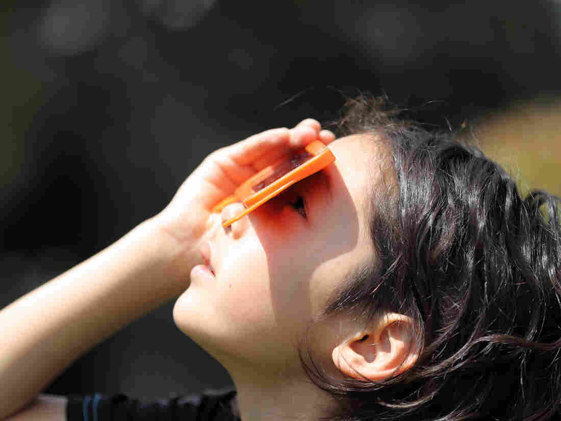 A child watches a solar eclipse on May 20, 2012, in Japan.