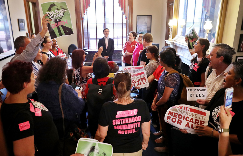 Dozens of people stand in the offices of Sen. Marco Rubio, R-Fla., protesting against the Republican health care plan on Capitol Hill on Thursday. Uncertainty about the future of the health care system has shaken insurers. (Chip Somodevilla/Getty Images)