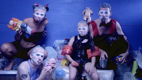 "A cast of Craigslist walk-ons wear garbage while striking a pose in a new video for the Moon Hooch song ""Booty House."""