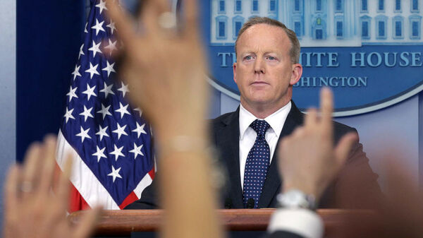 White House press secretary Sean Spicer conducts a press briefing in June. He announced on Friday that he was stepping down from his job in the Trump administration and would continue his service through August.