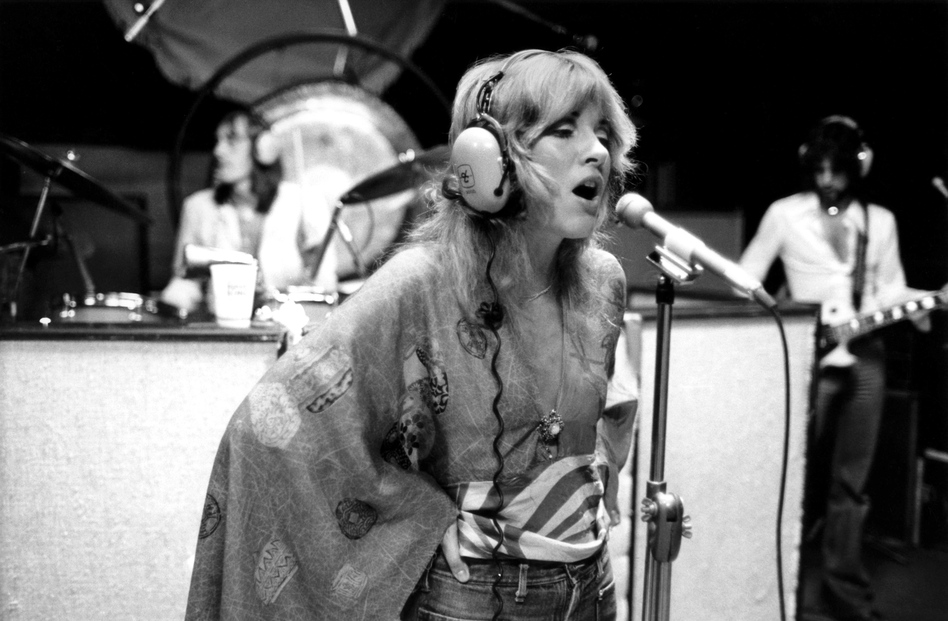Stevie Nicks and Fleetwood Mac in the recording studio, circa 1975.