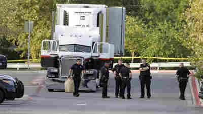 At Least 9 Dead, Dozens More Found In Tractor-Trailer In San Antonio