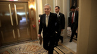 Senate Majority Leader Mitch McConnell, R-Ky., walks to a meeting in the U.S. Capitol on Tuesday. The U.S. Senate is scheduled to hold a key procedural vote health care.