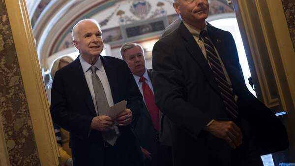 Sen. John McCain, R-Ariz., leaves after a procedural vote on health care on Capitol Hill on Tuesday. McCain also addressed his colleagues on the floor.