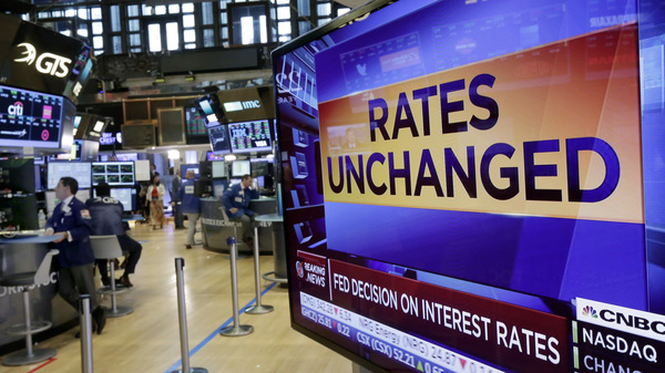 A television screen on the floor of the New York Stock Exchange shows the Federal Reserve