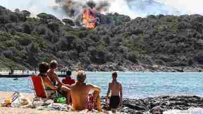 French Wildfires Force 12,000 People To Flee Coastal Resort Areas