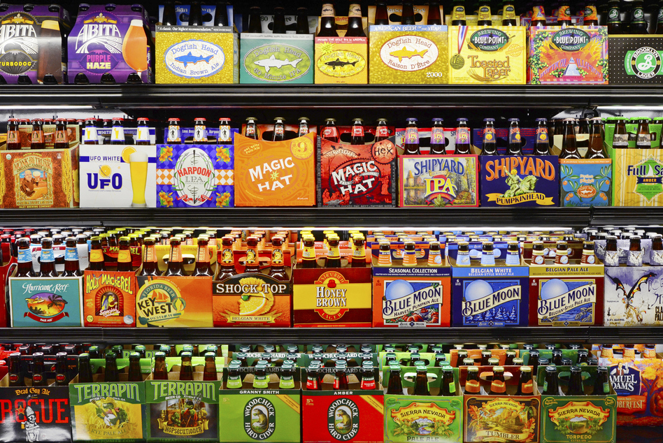 Can you spot the microbrews? Craft beer brands purchased by larger companies now almost dominate many supermarket and liquor store shelves. (bauhaus1000/Getty Images)