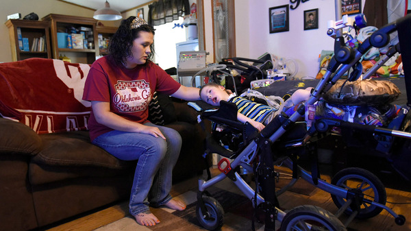 Amanda Chaffin comforts son Kayden, 4, who has a genetic condition called spinal muscular atrophy, or SMA, and depends on a ventilator to breathe. Chaffin is worried about the high costs of Kayden
