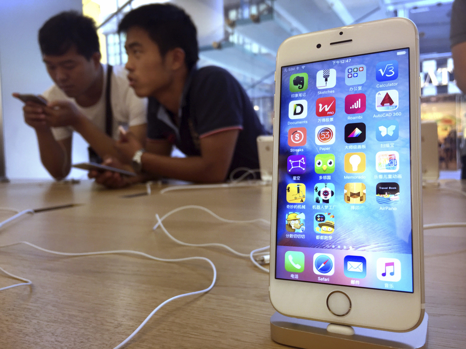 Apple has been accused of removing apps from its China App Store that can be used to skirt the country's Internet filters. Above, customers at an Apple Store in Beijing in 2016. (Mark Schiefelbein/AP)