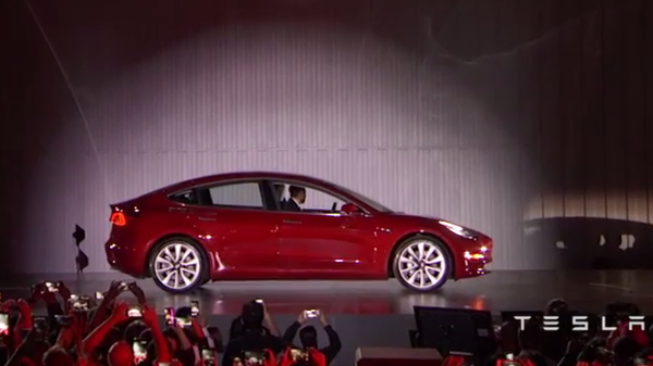 Tesla CEO Elon Musk arrives at a special event in the company