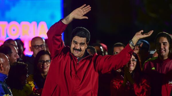 Venezuelan President Nicolas Maduro celebrates the results of Sunday