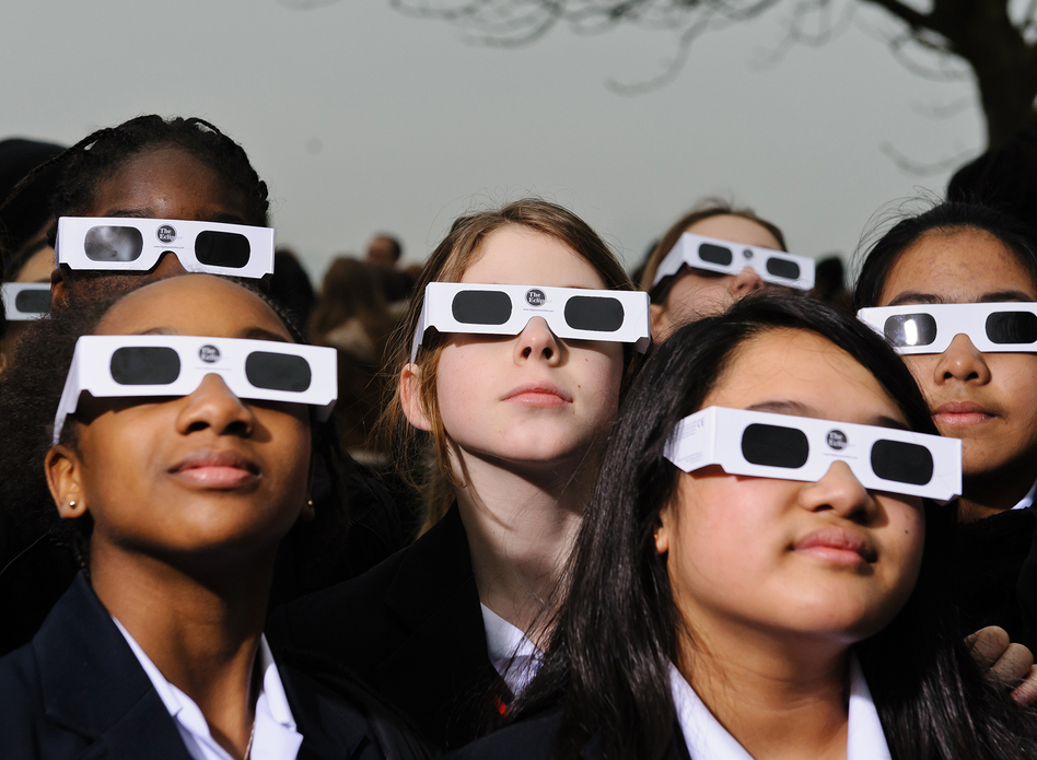 Proper eye protection is a must for anyone looking up at a solar eclipse. Eclipse glasses are far darker than regular sunglasses. (Joseph Okpako/Getty Images)