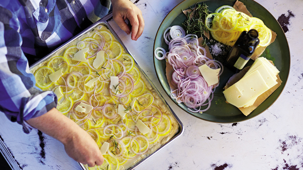 Focaccia topped with lemon pecorino and red onions is just one of the recipes featured in Bianco
