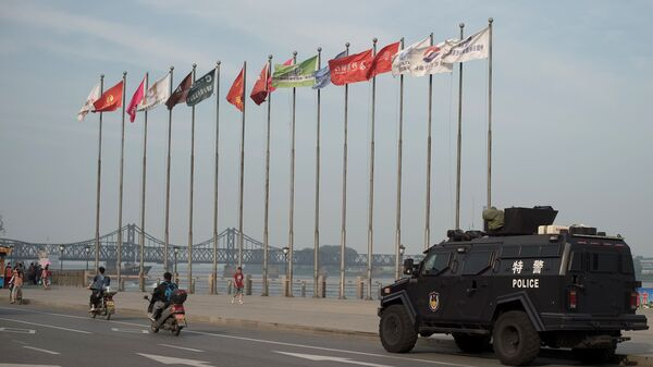 An armored Chinese police van is seen next to the Friendship Bridge on the Yalu River connecting the North Korean town of Sinuiju and the Chinese city of Dandong. China is North Korea