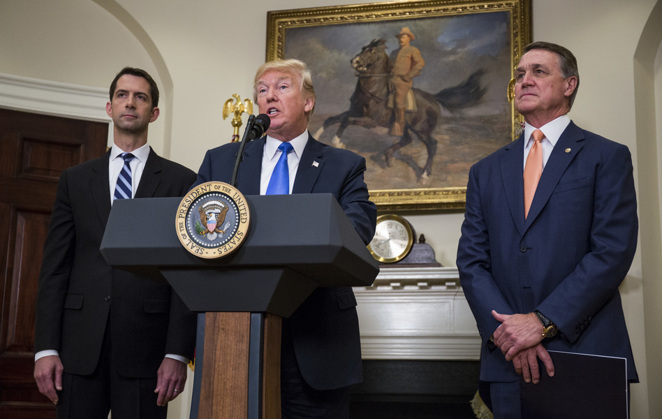 President Trump announces the introduction of the Reforming American Immigration for a Strong Economy (RAISE) Act with Sen. Tom Cotton, R-Ark. (left), and Sen. David Perdue, R-Ga., in the Roosevelt Room at the White House on Wednesday. (Getty Images)