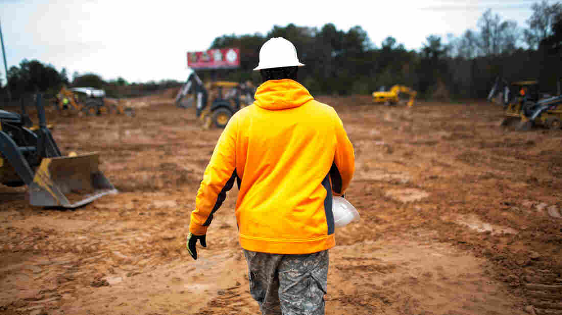 A man walks through a construction site during a training on heavy construction equipment in Conyers, Ga.