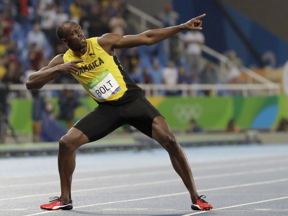 Usain Bolt from Jamaica celebrates winning the gold medal in the men's 200-meter final during the athletics competitions of the 2016 Summer Olympics at the Olympic stadium in Rio de Janeiro, Brazil. (David J. Phillip/AP)