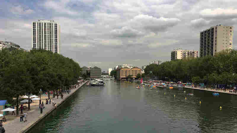 Locals Escape Summer's Heat With A Dip In A Parisian Canal