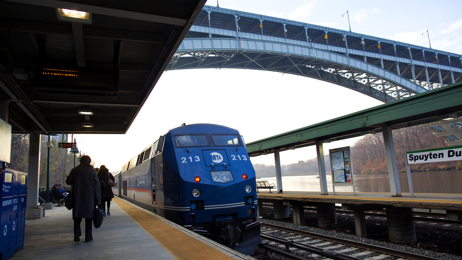 A Metro-North passenger train rolls through the Spuyten Duyvil station in New York in December of 2013, days after a train derailed in a deadly crash as it approached the station.
