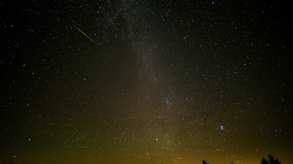 In a 30-second exposure, a meteor streaks across the sky during the annual Perseid meteor shower last year in Spruce Knob, W. Va.