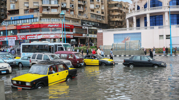Drivers maneuver through flood water after a torrential rain in Alexandria, Egypt.