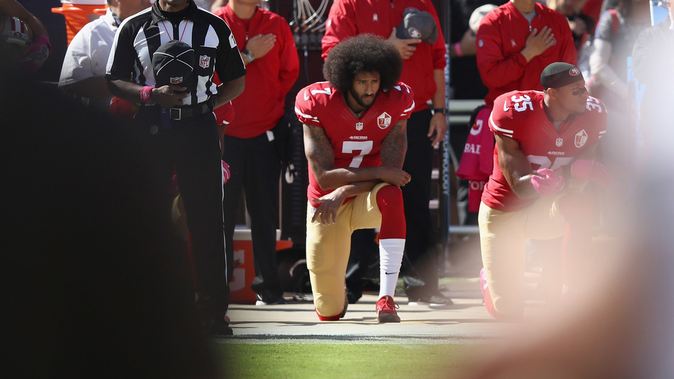 Colin Kaepernick kneels for the national anthem before a game last October in Santa Clara, Calif. (Ezra Shaw/Getty Images)