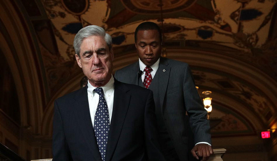 Special counsel Robert Mueller (left) arrives at the U.S. Capitol for a closed meeting with members of the Senate Judiciary Committee on June 21.