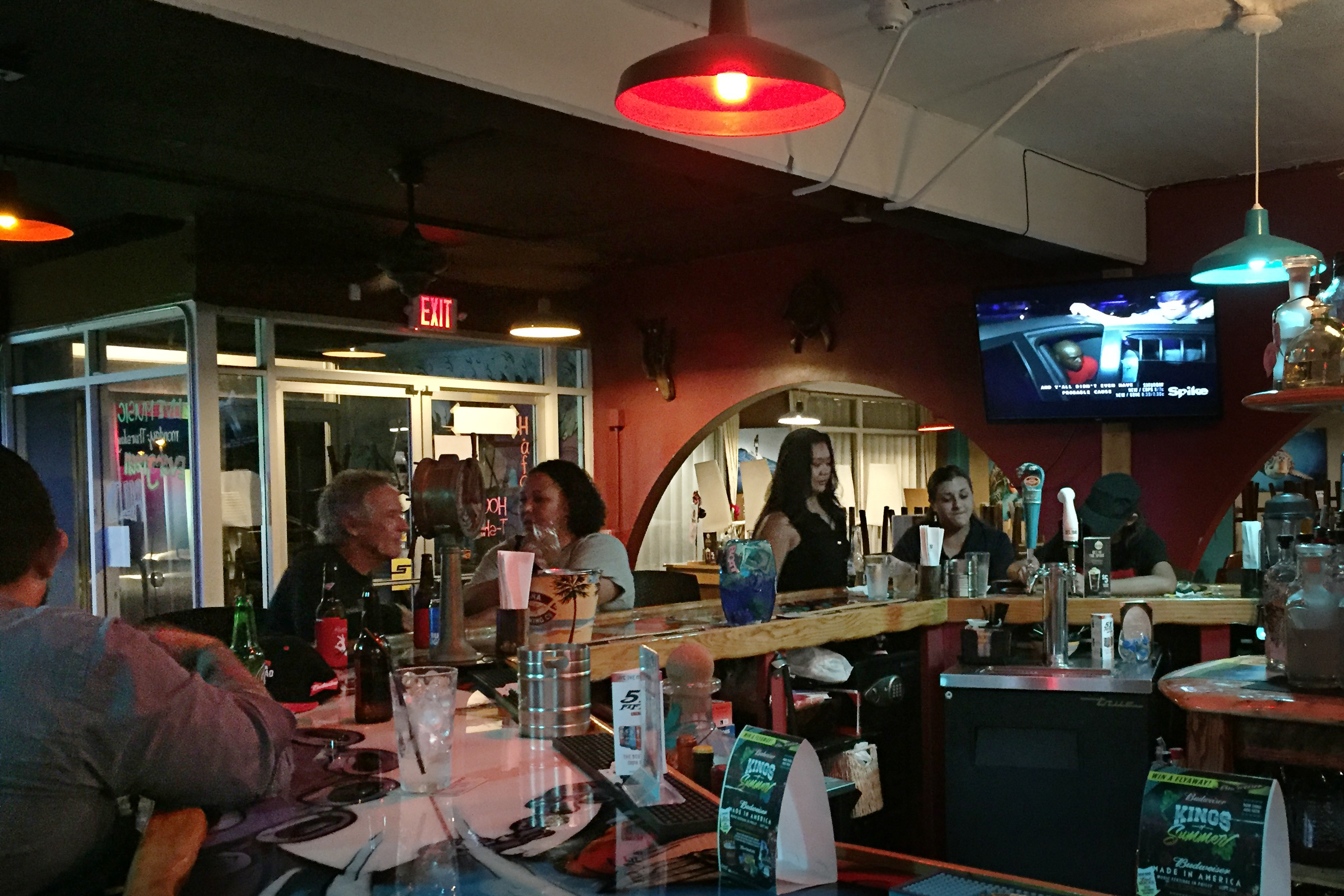 At Mosa's Joint in Guam island residents and military personnel fill up the bar for Thursday happy hour