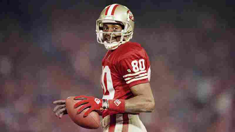Jerry Rice smiles during a game at on Dec. 3, 1994 at Candlestick Park in San Francisco.