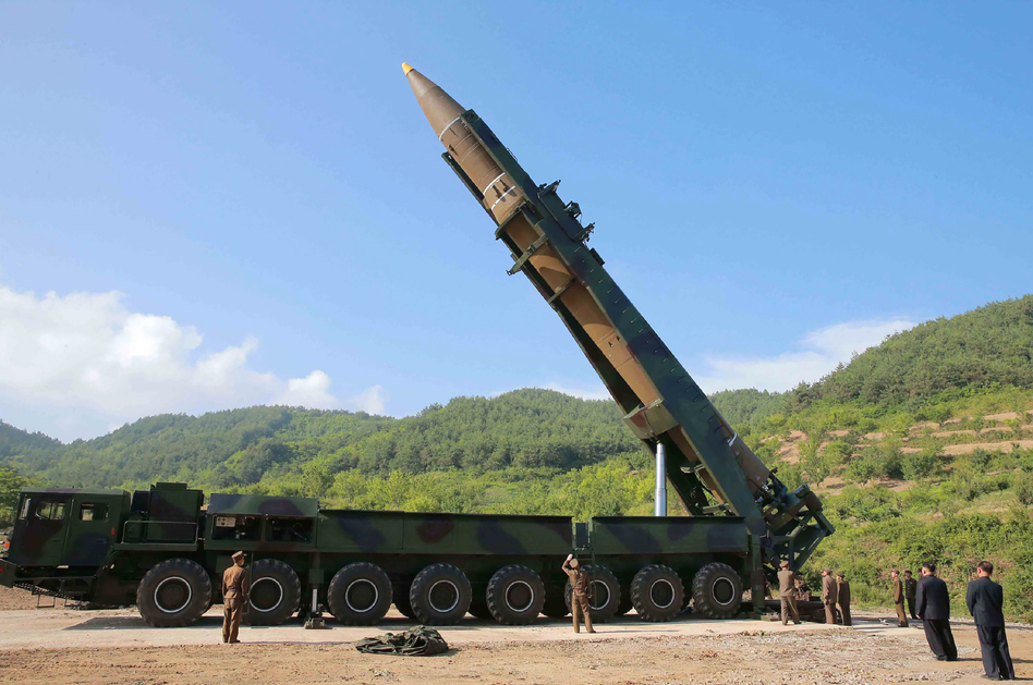 This picture taken and released on July 4 by an official North Korea news agency shows  leader Kim Jong-Un (second from right) inspecting the test firing of a Hwasong-14 ICBM at an undisclosed location. (STR/AFP/Getty Images)