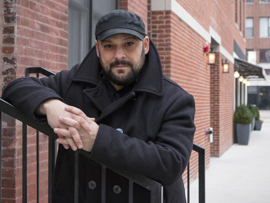 Christian Picciolini, founder of the group Life After Hate, poses for a photograph outside his Chicago home. Picciolini, a former skinhead, is an activist combatting what many see as a surge in white nationalism across the United States. (Teresa Crawford/AP)