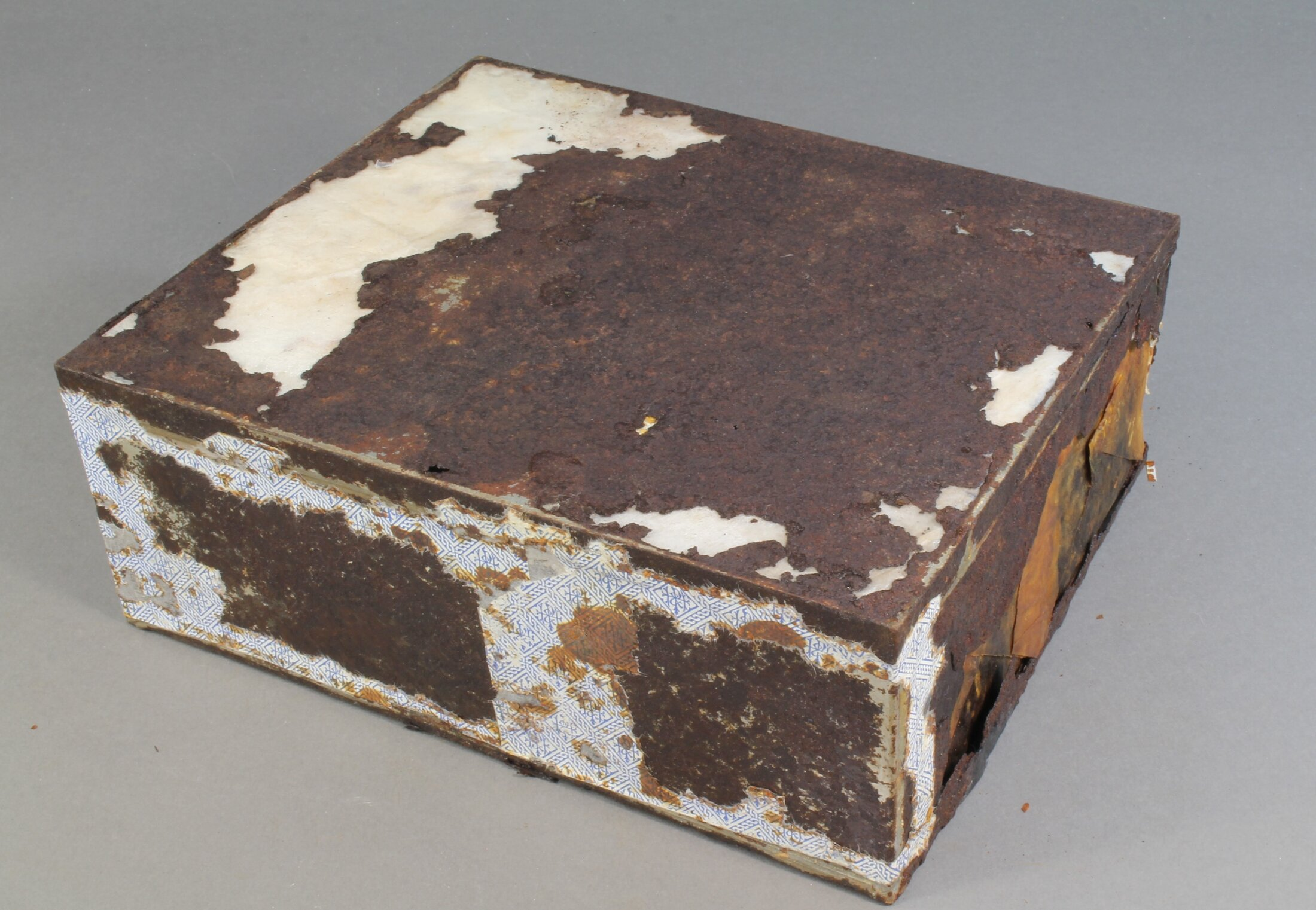 The fruitcake's tin is not as well preserved as the cake itself.     (Antarctic Heritage Trust)