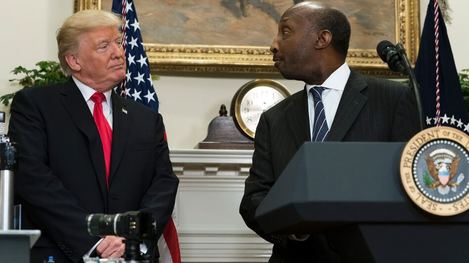 Kenneth Frazier, the CEO of Merck, said he was stepping down from a business council as a matter of personal conscience. He's seen here with President Trump during a White House event in July. (Saul Loeb/AFP/Getty Images)