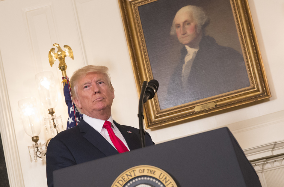 President Trump prepares on Monday to make a statement denouncing white supremacists who participated in the weekend violence in Charlottesville, Va. (Getty Images)