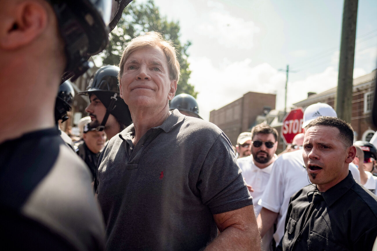 David Duke (center) participates in a rally where a crowd of white nationalists is met by a group of counterprotesters in Charlottesville, Va., on Saturday. (Justin Ide/Reuters)