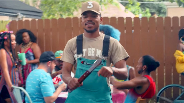 "Chance The Rapper mans the barbecue in a scene from a new video for the song ""LSD."""