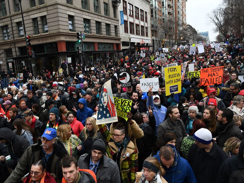 The Department of Justice has issued a warrant for a web hosting company to turn over all records related to the website of #DisruptJ20, a group that organized actions to spoil President Trump's inauguration in January. (Jewel Samad/AFP/Getty Images)