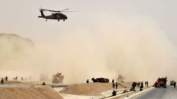 A U.S. black hawk helicopter flies over the site of a Taliban suicide attack in Kandahar, Afghanistan on Aug. 2.