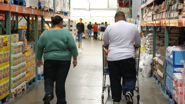 Customers browse a Costco store.
