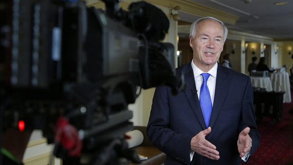 Arkansas Gov. Asa Hutchinson, pictured here during an interview last month, ended the state