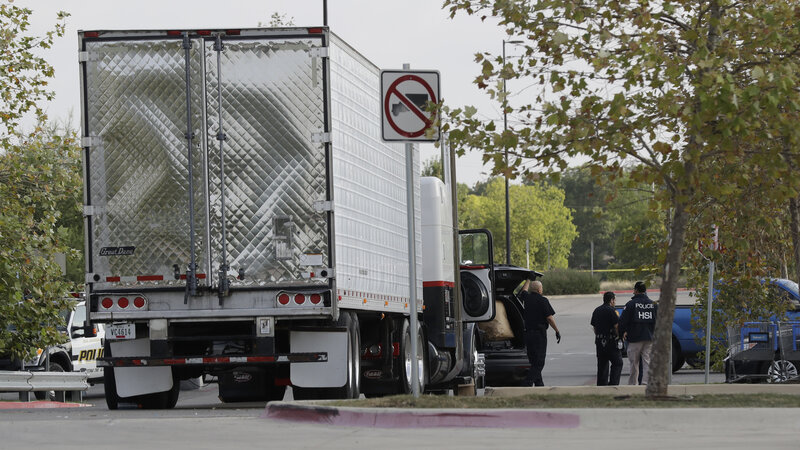 The unventilated tractor-trailer loaded with people was found at a Wal-Mart parking lot in San Antonio in July. (Eric Gay/AP)