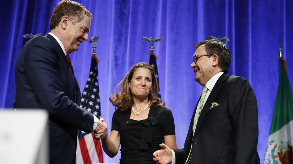 U.S. Trade Representative Robert Lighthizer (left) shakes hands with Canadian Foreign Affairs Minister Chrystia Freeland, accompanied by Mexico's Secretary of Economy Ildefonso Guajardo, after they spoke at a news conference Wednesday at the start of NAFTA renegotiations in Washington, D.C. (Jacquelyn Martin/AP)