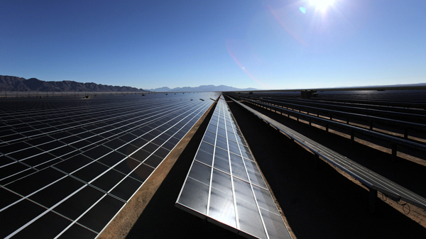 Solar cells sit in the sun at the Desert Sunlight Solar Farm in Desert Center, Calif. The people who run California
