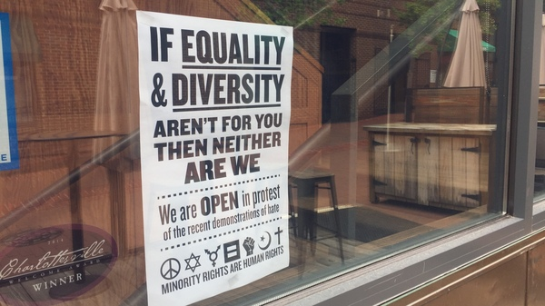 "Several downtown stores have put up signs and placards declaring: ""This is Our Town"" and ""If Equality and Diversity Aren"