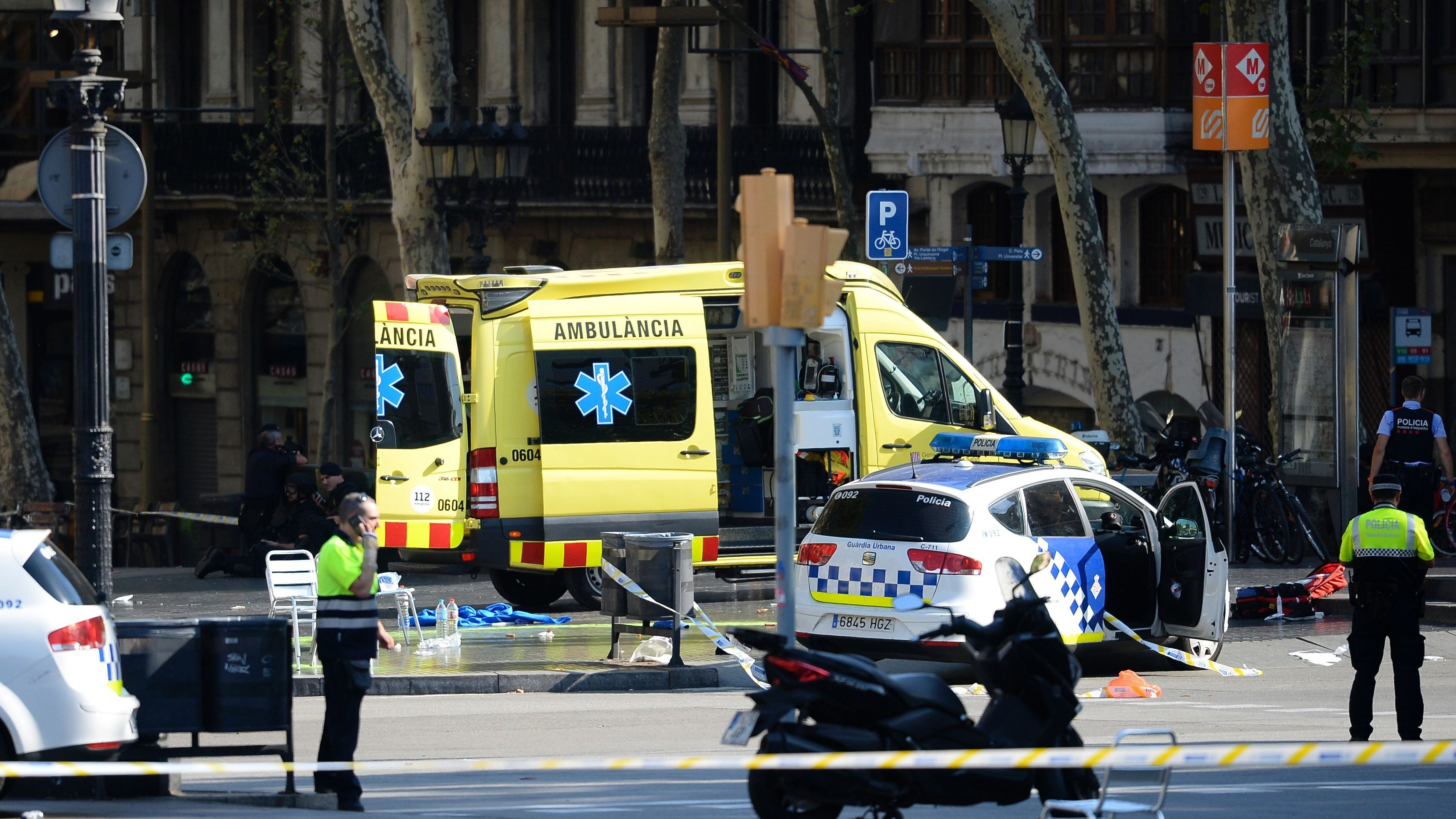 Emergency personnel cordon off the area where a van plowed into a crowd on Las Ramblas boulevard in Barcelona on Thursday. (Josep Lago/AFP/Getty Images)